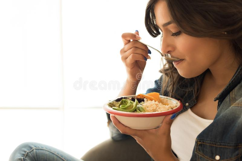 Woman eating a healthy bowl. Of superfoods royalty free stock photo
