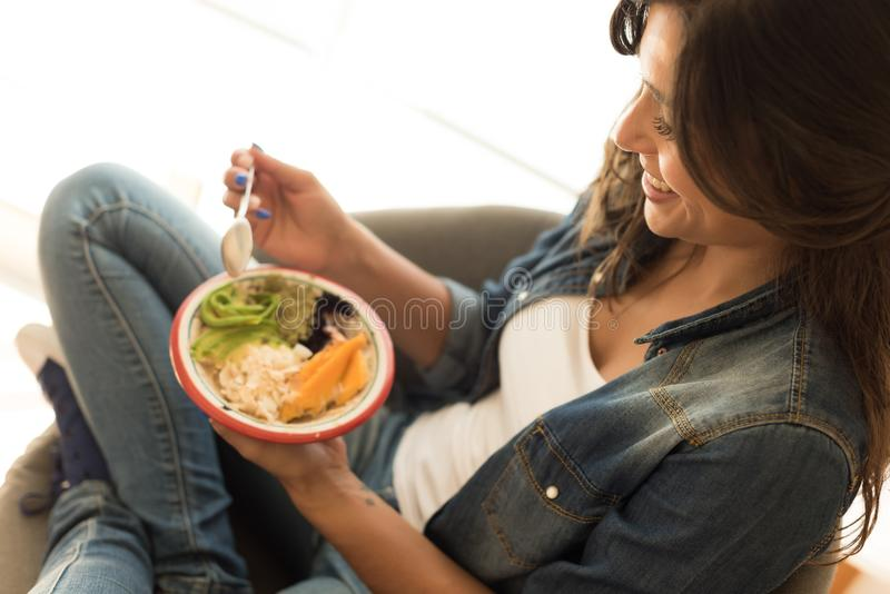 Woman eating a healthy bowl. Of superfoods royalty free stock photography