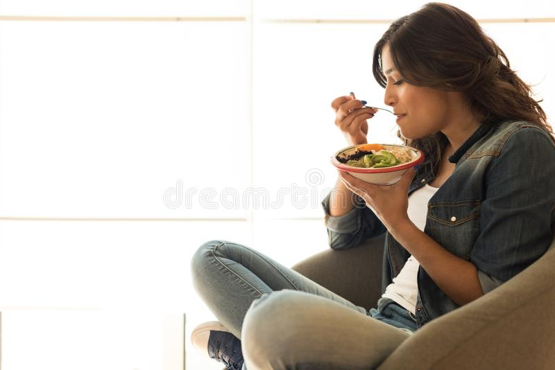 Woman eating a healthy bowl. Of superfoods royalty free stock images