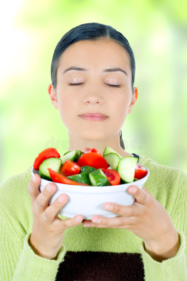Woman eating healthy food royalty free stock photo