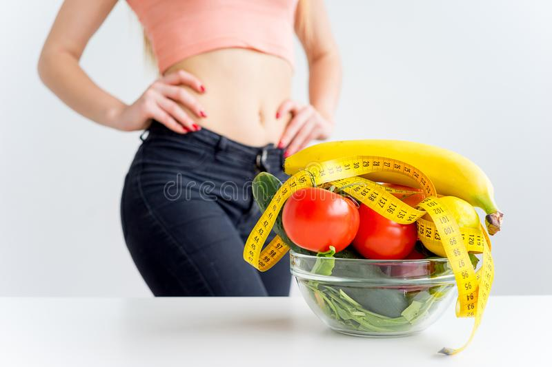 Woman eating healthy. A woman eating healthy food on a diet royalty free stock photography
