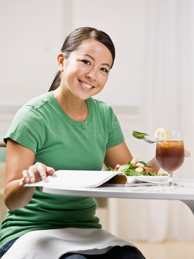 Download Woman Eating Healthy Lunch While Reading Magazine Stock Images - Image: 6603154
