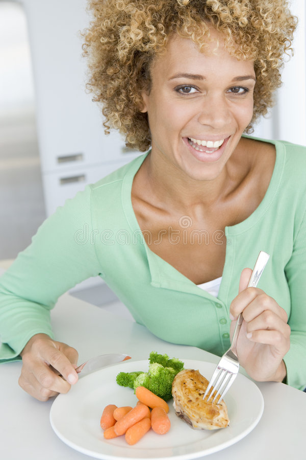 Woman Eating Healthy meal, mealtimes. Smiling stock photo