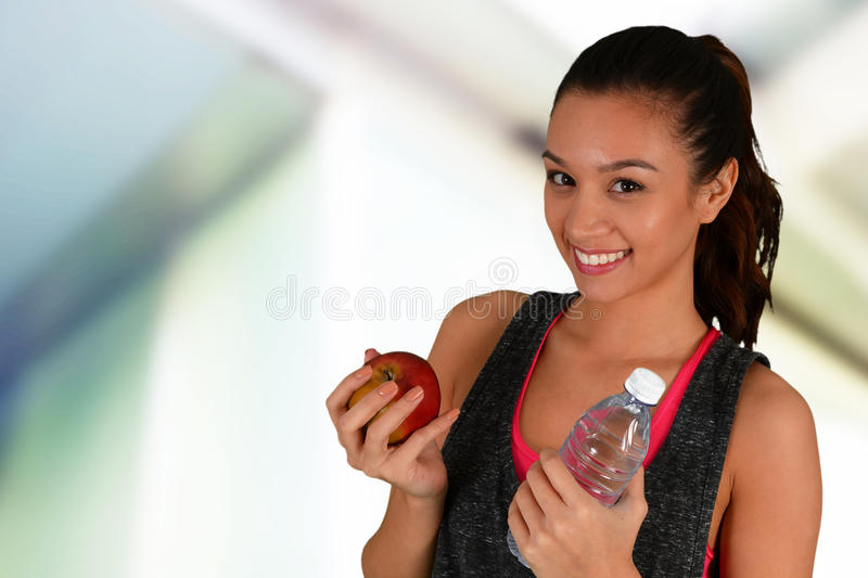 Woman Eating Healthy After Workout. Woman eating healthy food after a workout royalty free stock images