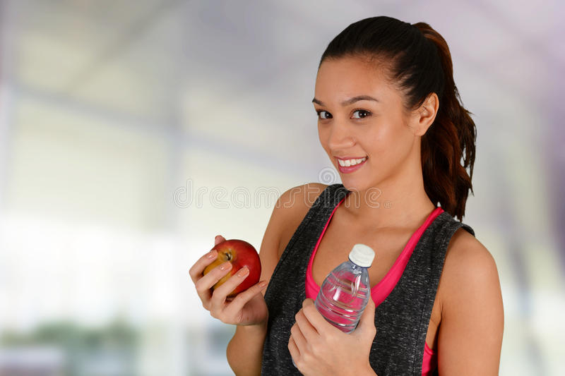 Woman Eating Healthy After Workout. Woman eating healthy food after a workout stock image