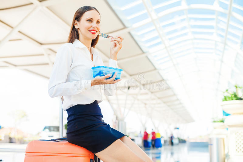 Woman eating homemade food from plastic container royalty free stock image