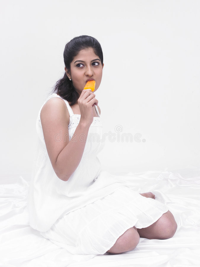 Download Woman eating an ice cream stock image. Image of beautiful - 7387297