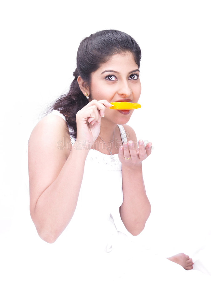 Download A Woman Eating An Ice Cream Royalty Free Stock Photos - Image: 7387298