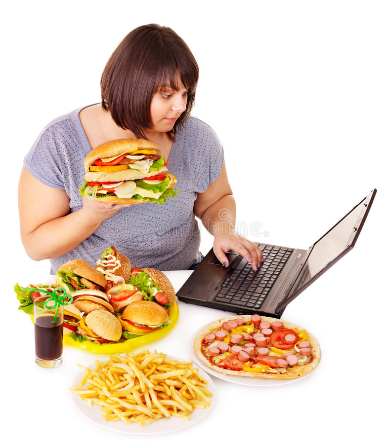 Woman eating junk food. Woman eating fast food at work. Isolated royalty free stock images