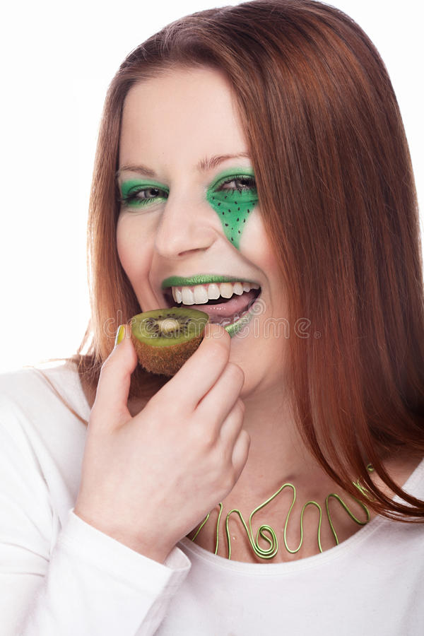 Woman eating kiwi stock images