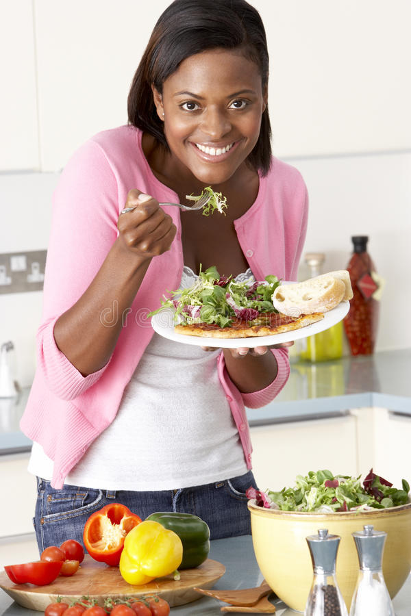 Download Woman Eating Meal In Kitchen Stock Image - Image: 10003075