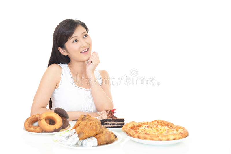 Woman eating meals stock image