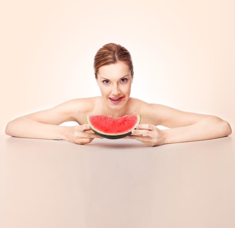 Woman eating melon royalty free stock photos
