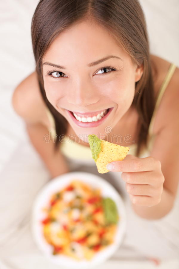 Download Woman eating nachos stock image. Image of adults, adult - 17719641