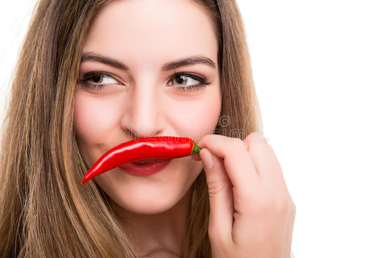 Woman eating pepper stock photo