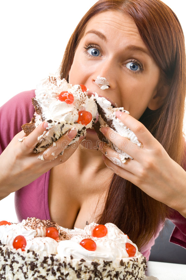 Woman eating pie, isolated royalty free stock images