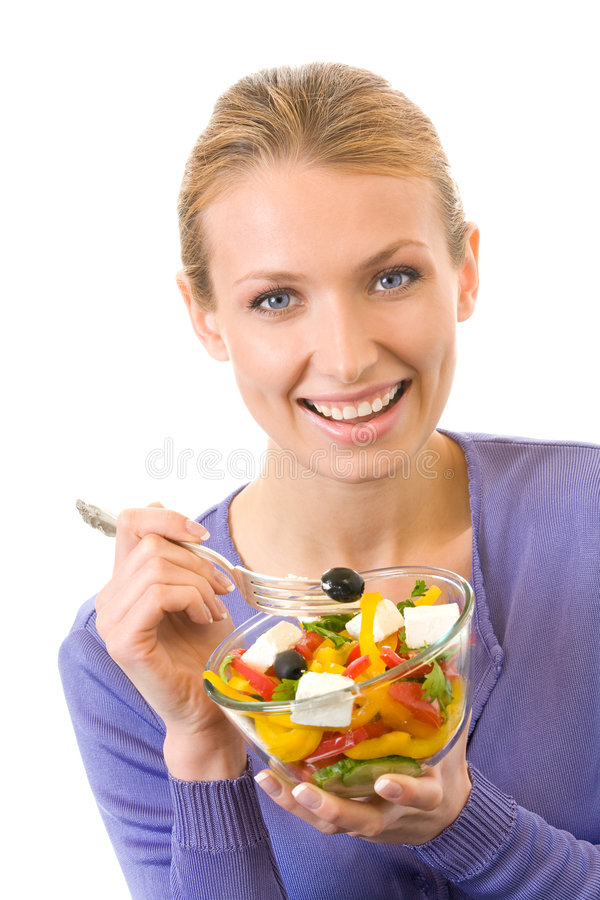 Woman eating salad, isolated. Young woman eating salad, isolated royalty free stock photo