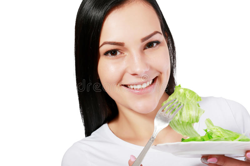 Woman eating salad stock photos