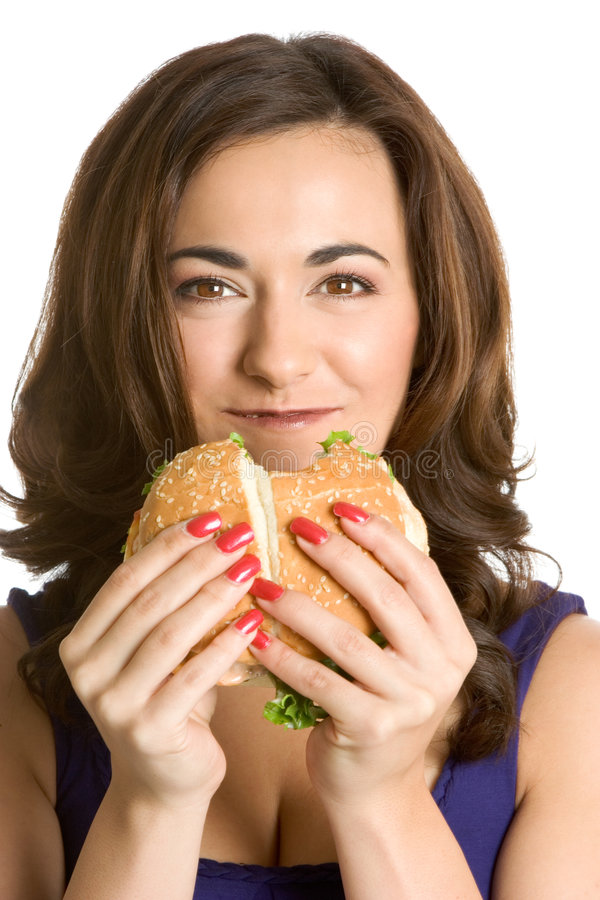 Woman Eating Sandwich. Beautiful isolated woman eating sandwich royalty free stock photo
