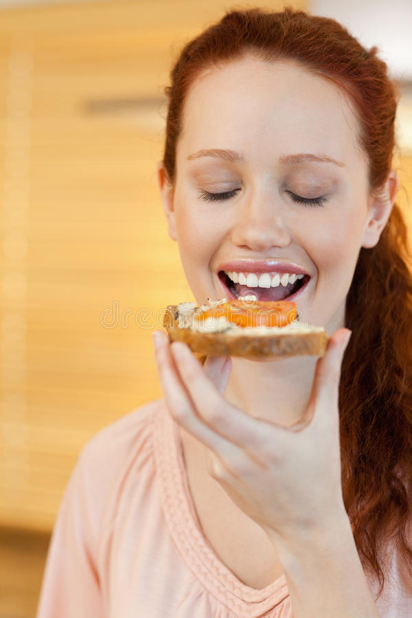 Woman Eating A Slice Of Bread Stock Image