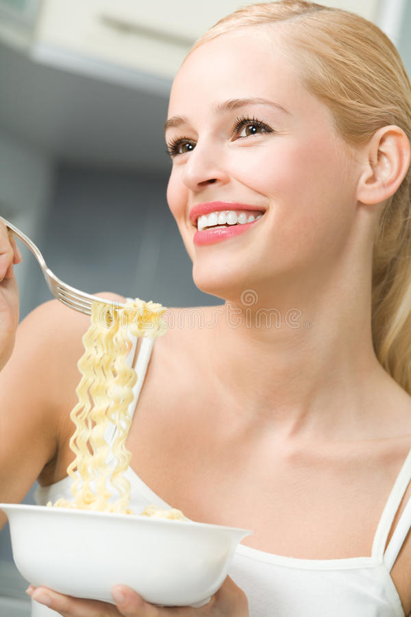 Woman eating spaghetti. At home stock photos