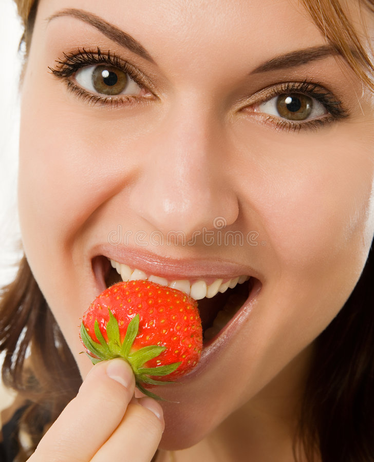 Download Woman eating a strawberry stock image. Image of dessert - 2670311