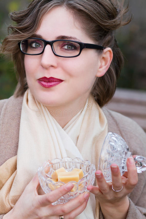Woman eating sweet candy, toffee caramel. Young woman eating sweet candy, toffee caramel royalty free stock photography