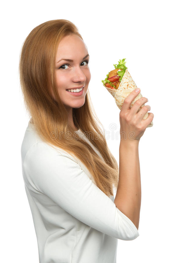 Woman eating tasty unhealthy burger twisted sandwich in hands stock photo