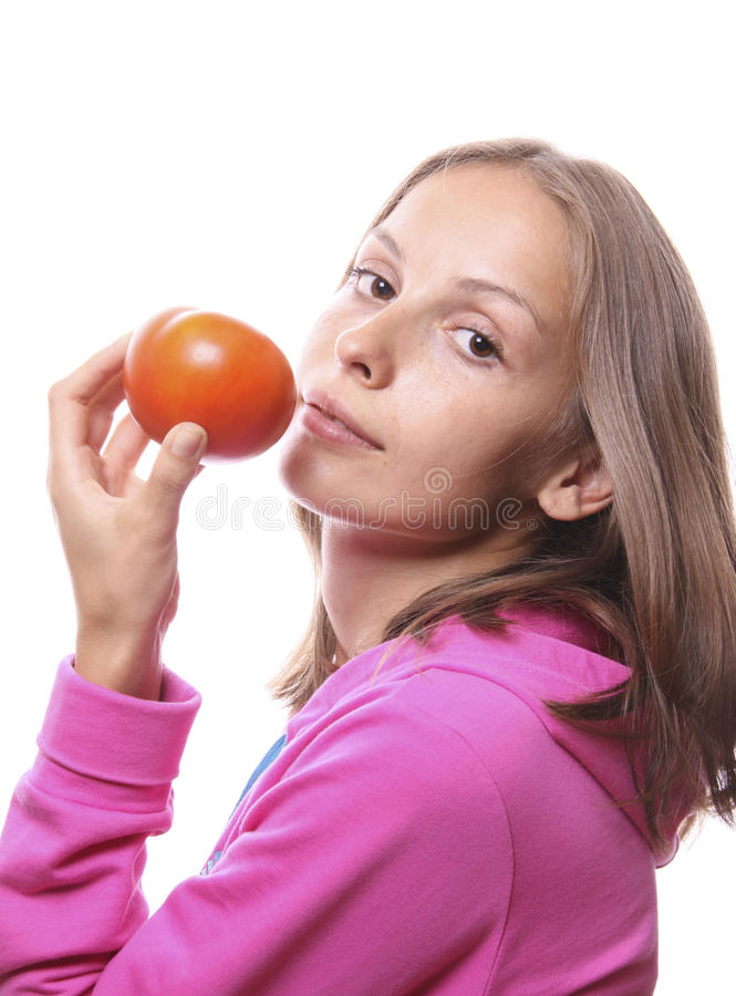 Download Woman Eating A Tomato, Isolated Royalty Free Stock Photo - Image: 24428455