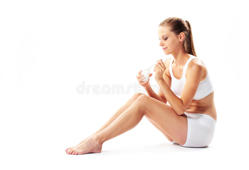 Download Woman eating yogurt stock photo. Image of background - 24552786
