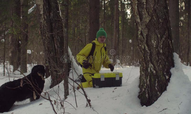 Woman ecologist in the forest at winter day royalty free stock photos