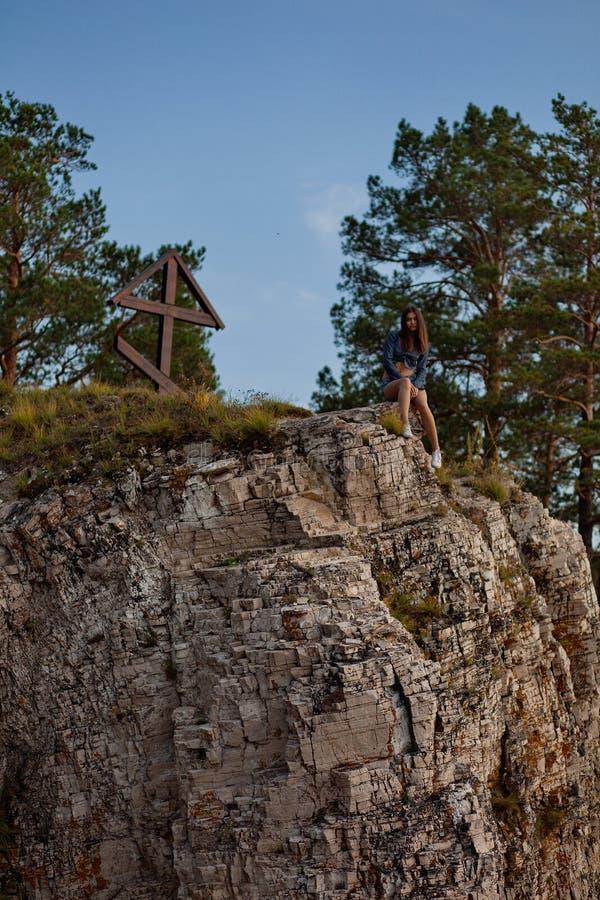 Woman on edge of cliff stock photo