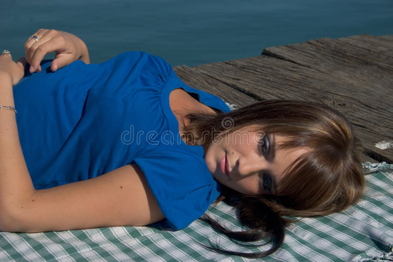 Download Woman At The Edge Of A Lake Lengthened Stock Image - Image: 4516211