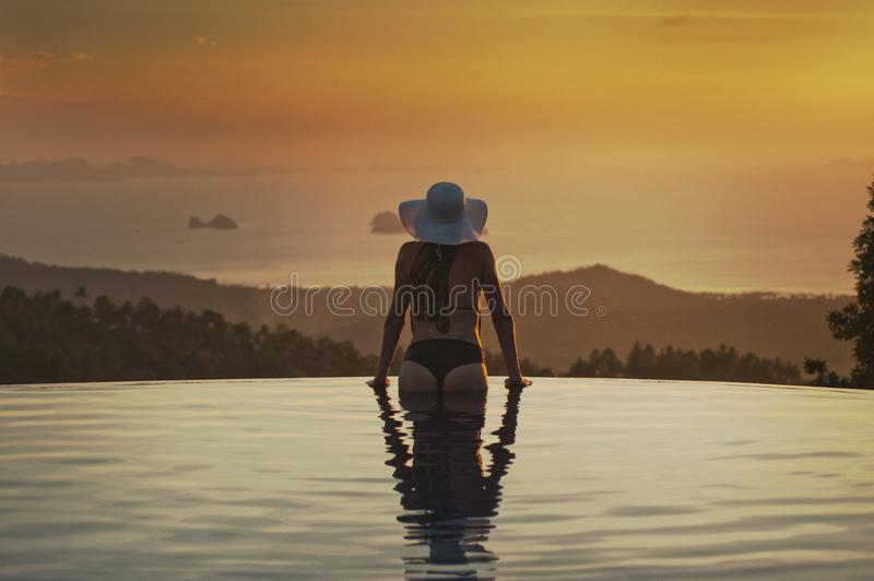 Woman At The Edge Of The Pool stock photography