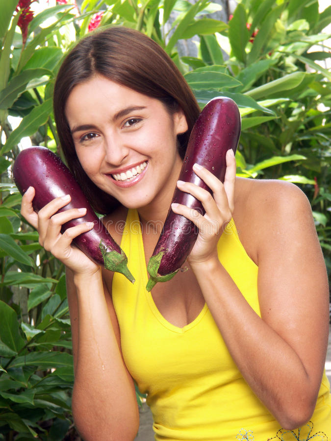 Woman eggplant. stock photos
