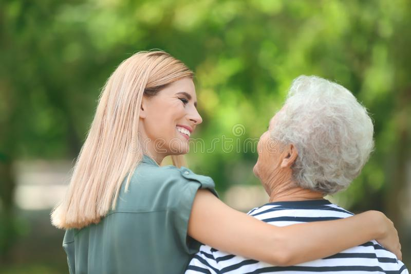 Woman with elderly mother outdoors royalty free stock photos