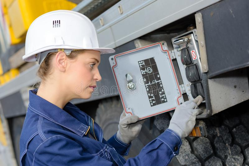 Woman electrician engineer inspecting electric counter utdoors. Woman royalty free stock photo