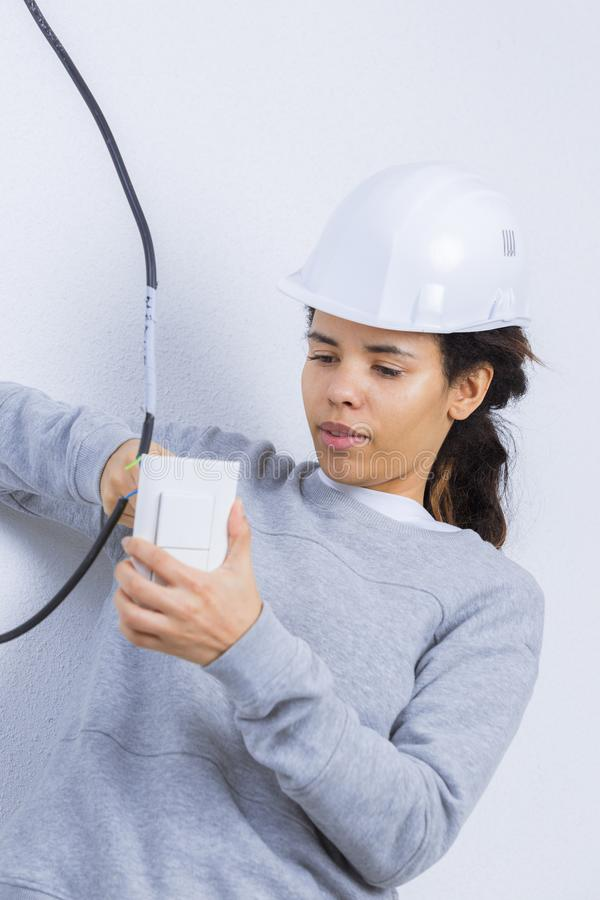 Woman electrician fixing socket people at work concept royalty free stock photos