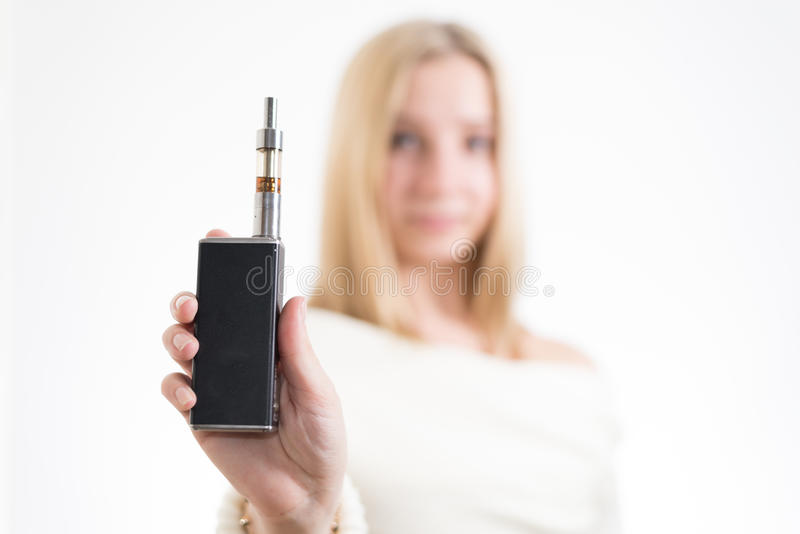 Woman with electronic cigarette. On white background royalty free stock photo