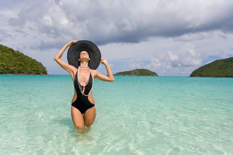 Woman elegant beach stock images