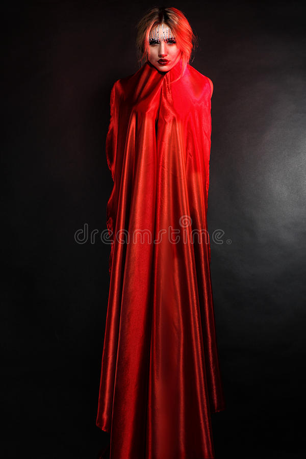 Woman in elegant red dress stock photography