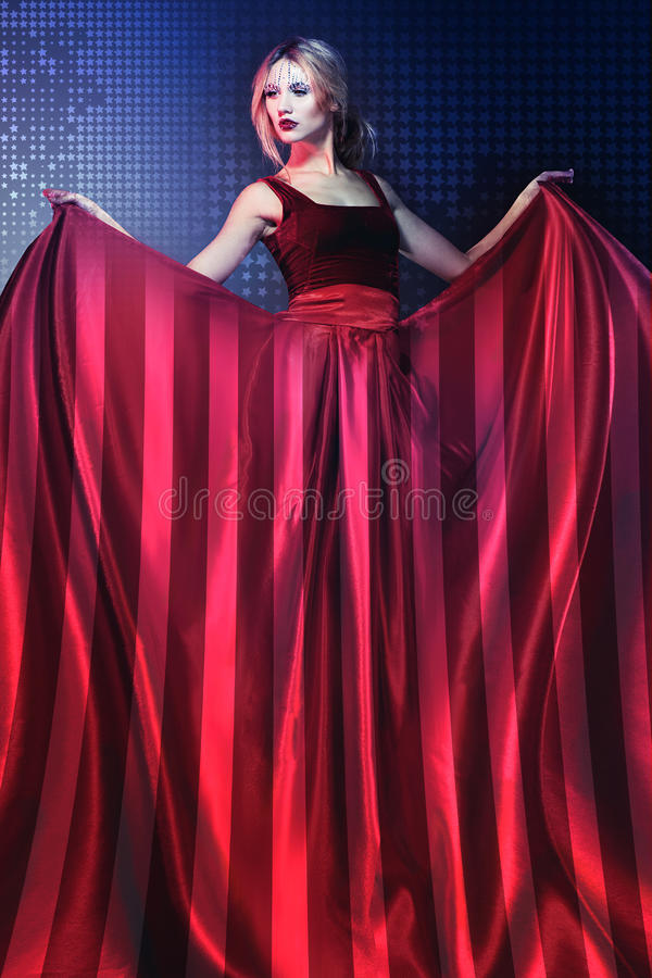 Woman in elegant red dress with American flag stock photo
