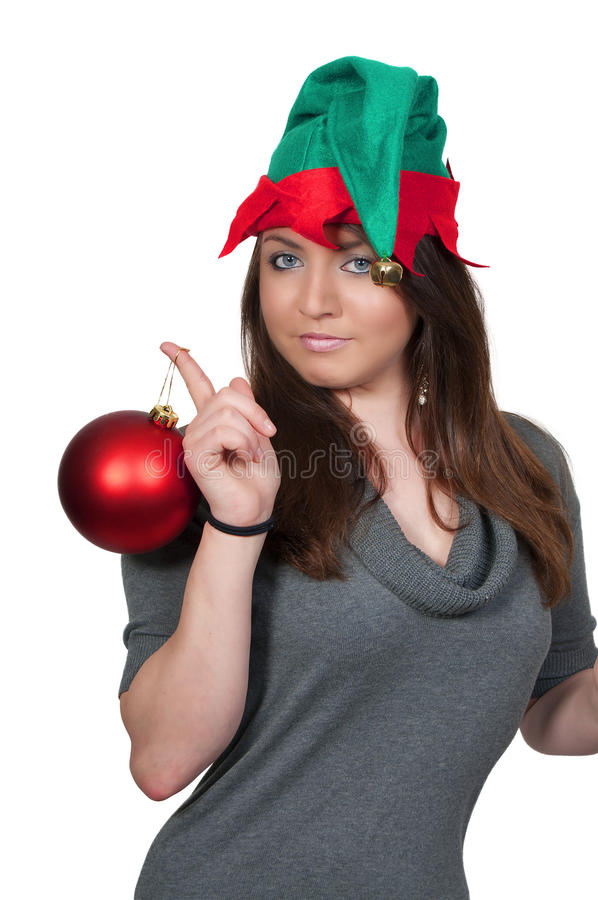 Woman Elf Holding Christmas Ornament stock photo