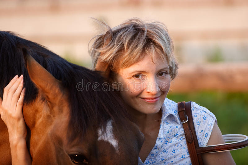 Woman Embrace Brown Horse Stock Image