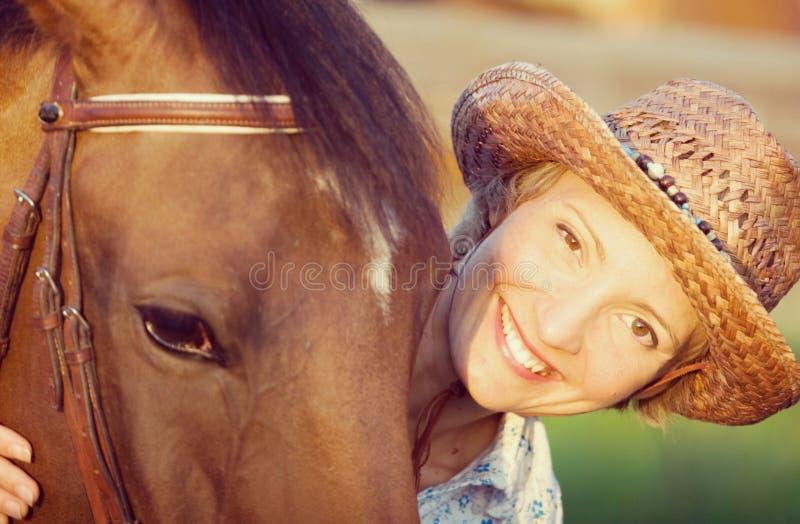 Woman embrace brown horse stock photos