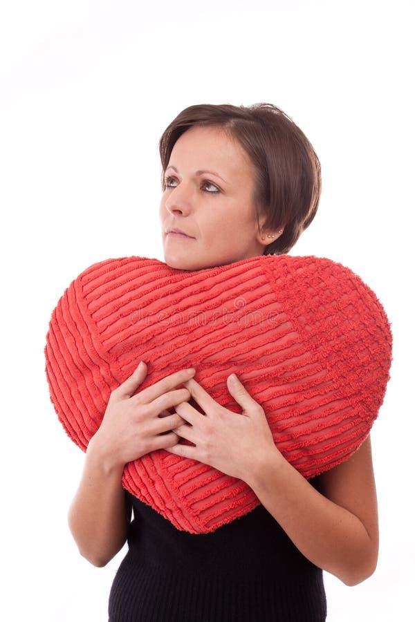 Woman Embrace A Heart-shape Pillow Royalty Free Stock Photos