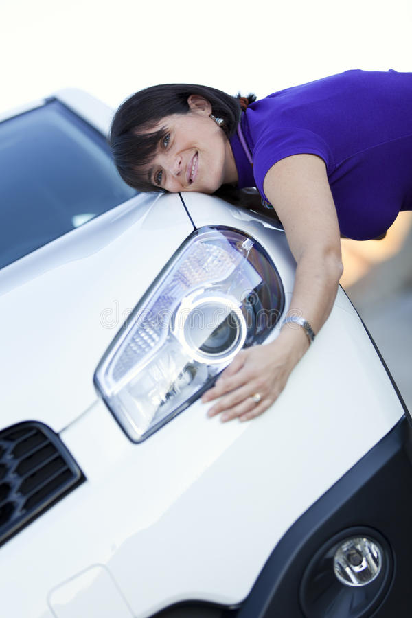 Woman embracing her new car royalty free stock photography
