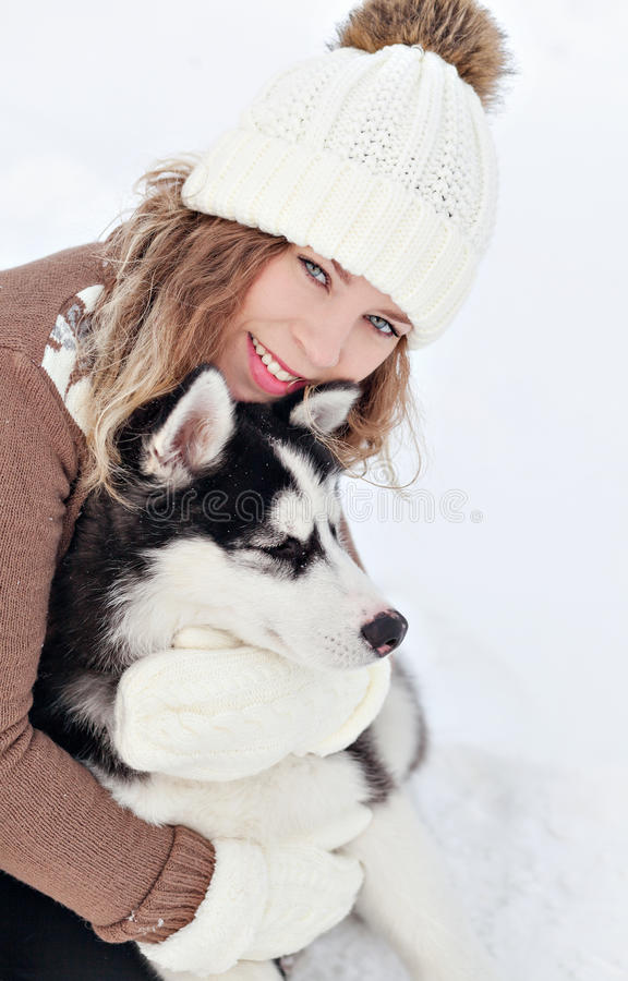 Woman embracing with a pup royalty free stock images