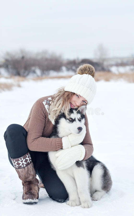 Woman embracing with a pup royalty free stock image