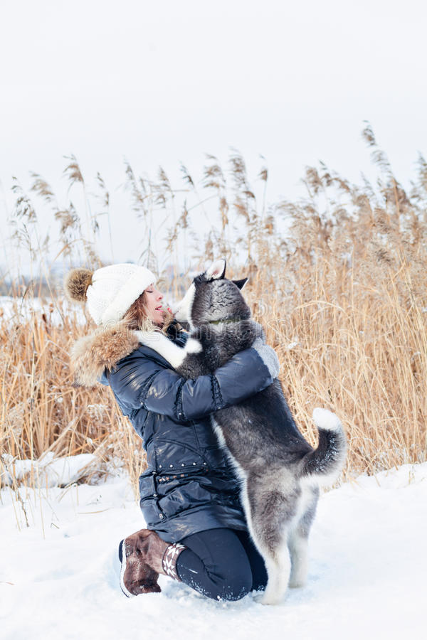 Woman embracing with a pup stock photography